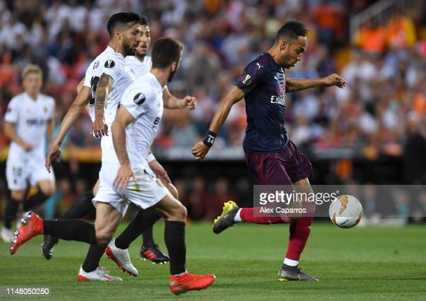 PierreEmerick Aubameyang of Arsenal scores his team's first goal during the UEFA Europa League Semi Final Second Leg match between Valencia and...