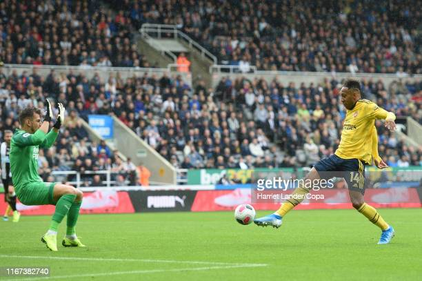 PierreEmerick Aubameyang of Arsenal scores his team's first goal during the Premier League match between Newcastle United and Arsenal FC at St James...