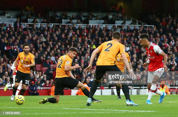PierreEmerick Aubameyang of Arsenal scores his team's first goal during the Premier League match between Arsenal FC and Wolverhampton Wanderers at...