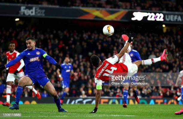 Pierre-Emerick Aubameyang of Arsenal scores his teams first goal during the UEFA Europa League round of 32 second leg match between Arsenal FC and...