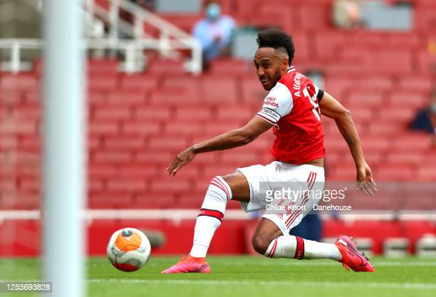 PierreEmerick Aubameyang of Arsenal scores his teams first goal during the Premier League match between Arsenal FC and Norwich City at Emirates...