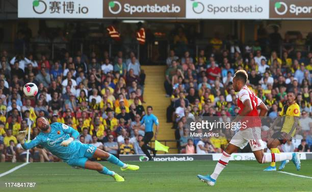 Pierre-Emerick Aubameyang of Arsenal scores his team's second goal past Ben Foster of Watford during the Premier League match between Watford FC and...