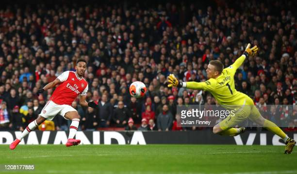PierreEmerick Aubameyang of Arsenal scores his team's second goal past Jordan Pickford of Everton during the Premier League match between Arsenal FC...