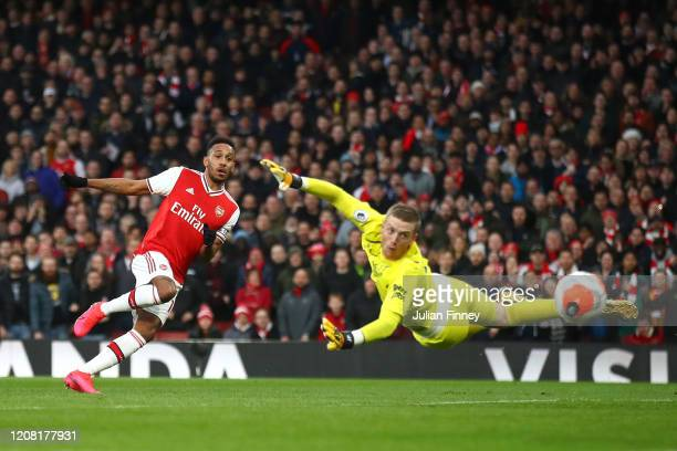 Pierre-Emerick Aubameyang of Arsenal scores his team's second goal past Jordan Pickford of Everton during the Premier League match between Arsenal FC...