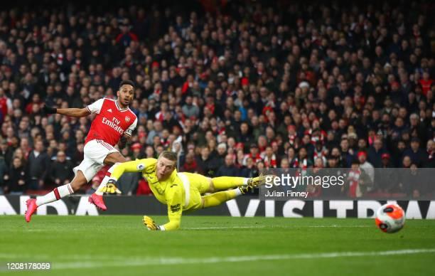 PierreEmerick Aubameyang of Arsenal scores his team's second goal past Jordan Pickford of Everton during the Premier League match between Arsenal FC...