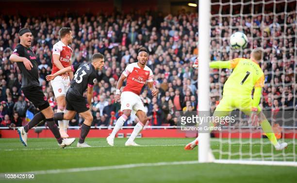 PierreEmerick Aubameyang of Arsenal scores his team's second goal during the Premier League match between Arsenal FC and Everton FC at Emirates...