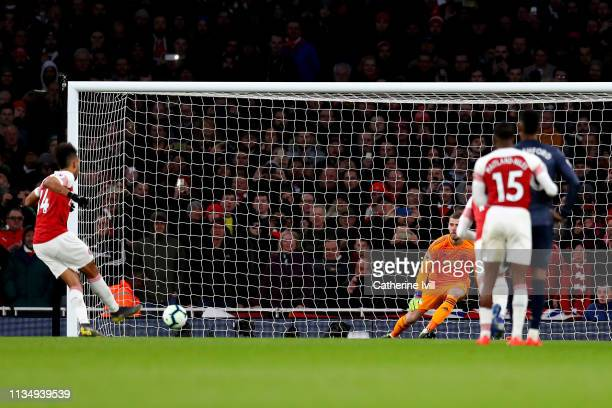 PierreEmerick Aubameyang of Arsenal scores his team's second goal during the Premier League match between Arsenal FC and Manchester United at...
