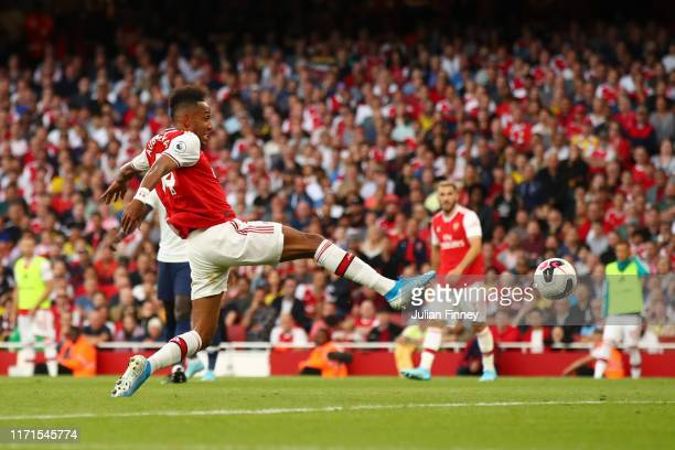 Pierre-Emerick Aubameyang of Arsenal scores his team's second goal during the Premier League match between Arsenal FC and Tottenham Hotspur at...