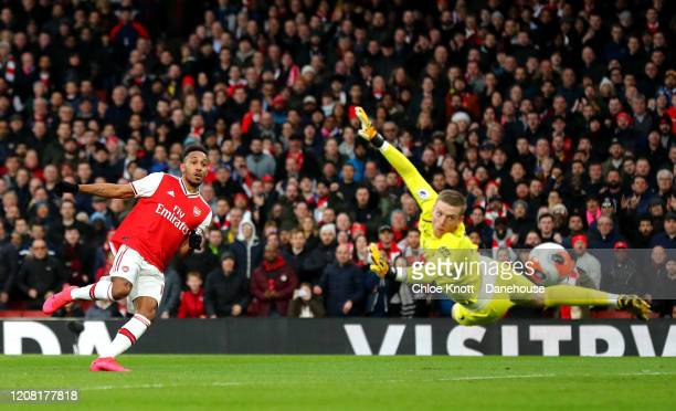 PierreEmerick Aubameyang of Arsenal scores his teams second goal during the Premier League match between Arsenal FC and Everton FC at Emirates...