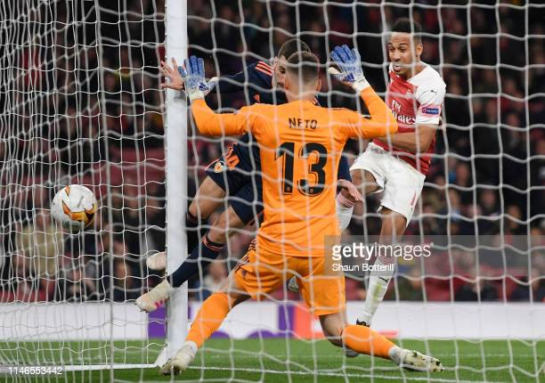 PierreEmerick Aubameyang of Arsenal scores his team's third goal past Jose Luis Gaya and Norberto Murara Neto of Valencia during the UEFA Europa...