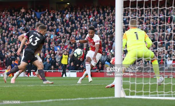 PierreEmerick Aubameyang of Arsenal scores the second goal during the Premier League match between Arsenal FC and Everton FC at Emirates Stadium on...