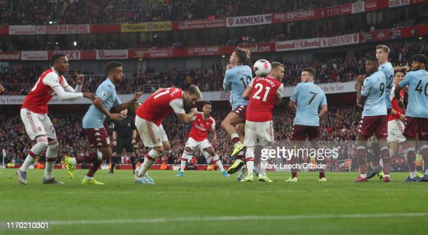 PierreEmerick Aubameyang of Arsenal scores the winning goal during the Premier League match between Arsenal FC and Aston Villa at Emirates Stadium on...