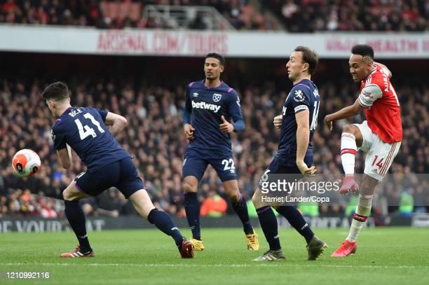 PierreEmerick Aubameyang of Arsenal shoots past Declan Rice Sebastien Haller and Mark Noble of West Ham United during the Premier League match...