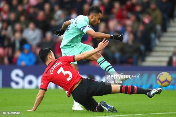 PierreEmerick Aubameyang of Arsenal shoots under pressure from Maya Yoshida of Southampton during the Premier League match between Southampton FC and...