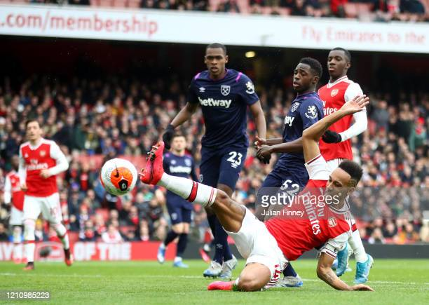 PierreEmerick Aubameyang of Arsenal stretches for the ball during the Premier League match between Arsenal FC and West Ham United at Emirates Stadium...