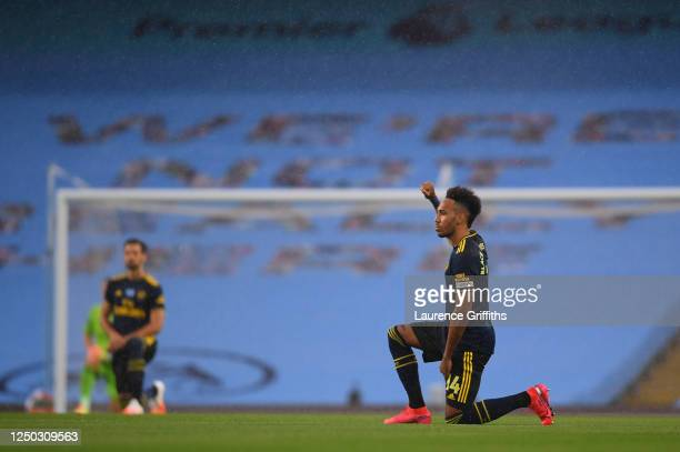 PierreEmerick Aubameyang of Arsenal takes a knee in support of the Black Lives Matter movement prior to the Premier League match between Manchester...