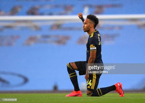 PierreEmerick Aubameyang of Arsenal takes a knee in support of the Black Lives Matter movement prior to during the Premier League match between...