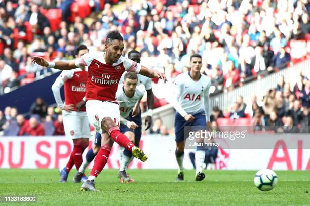 Pierre-Emerick Aubameyang of Arsenal takes a penalty which is saved by Hugo Lloris of Tottenham Hotspur during the Premier League match between...
