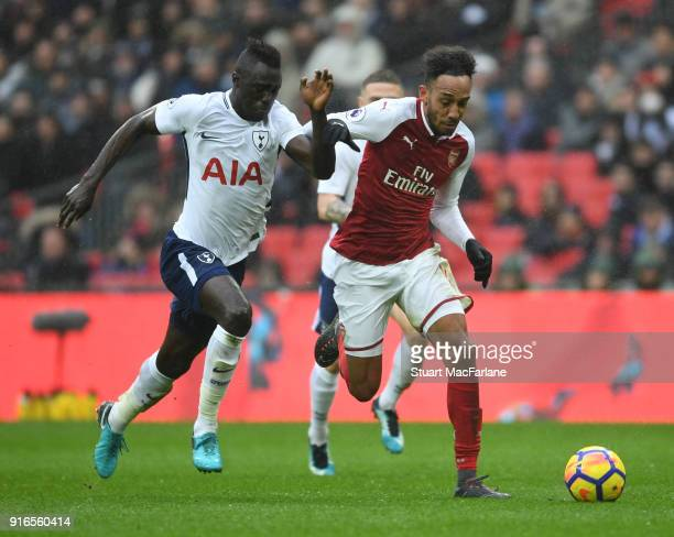 PierreEmerick Aubameyang of Arsenal takes on Davinson Sanchez of Tottenham during the Premier League match between Tottenham Hotspur and Arsenal at...