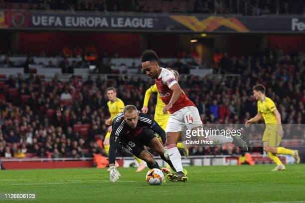PierreEmerick Aubameyang of Arsenal takes on Denis Scherbitski of BATE during the UEFA Europa League Round of 32 Second Leg match between Arsenal and...