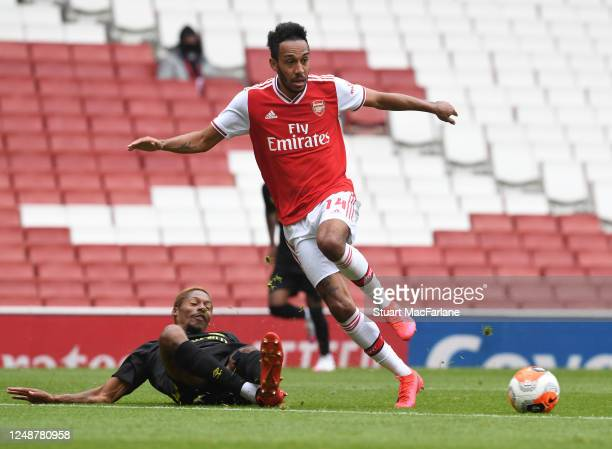 PierreEmerick Aubameyang of Arsenal takes on Ethan Pinnock of Brentford during a friendly match between Arsenal and Brentford at Emirates Stadium on...
