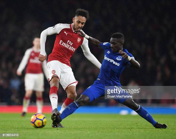 PierreEmerick Aubameyang of Arsenal takes on Idrissa Gueye of Everton during the Premier League match between Arsenal and Everton at Emirates Stadium...