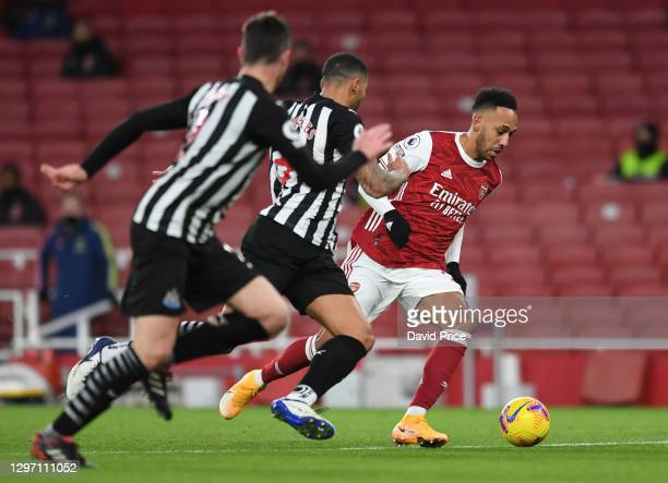 Pierre-Emerick Aubameyang of Arsenal takes on Jamaal Lascelles of Newcastle during the Premier League match between Arsenal and Newcastle United at...