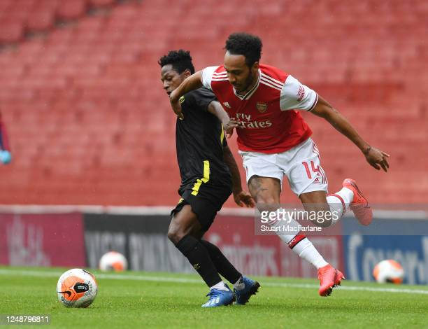 PierreEmerick Aubameyang of Arsenal takes on Kamohelo Mokotjo of Brentford during a friendly match between Arsenal and Brentford at Emirates Stadium...