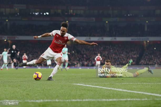 PierreEmerick Aubameyang of Arsenal takes the ball around Bournemouth goalkeeper Artur Boruc to score the fourth goal for his team during the Premier...