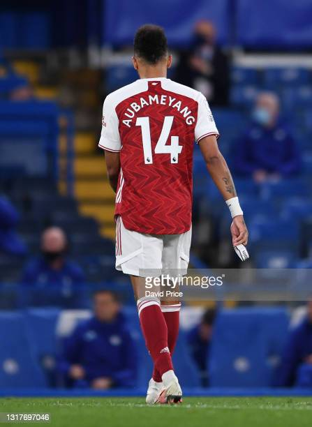 Pierre-Emerick Aubameyang of Arsenal walks off the pitch with his captains armband in his hand during the Premier League match between Chelsea and...