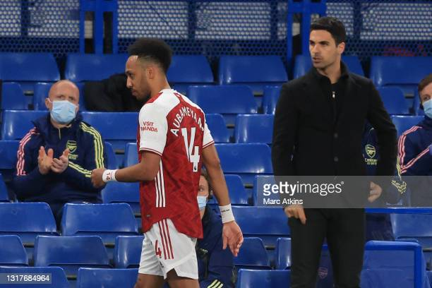Pierre-Emerick Aubameyang of Arsenal walks past Mikel Arteta, Manager of Arsenal as he is substituted off during the Premier League match between...