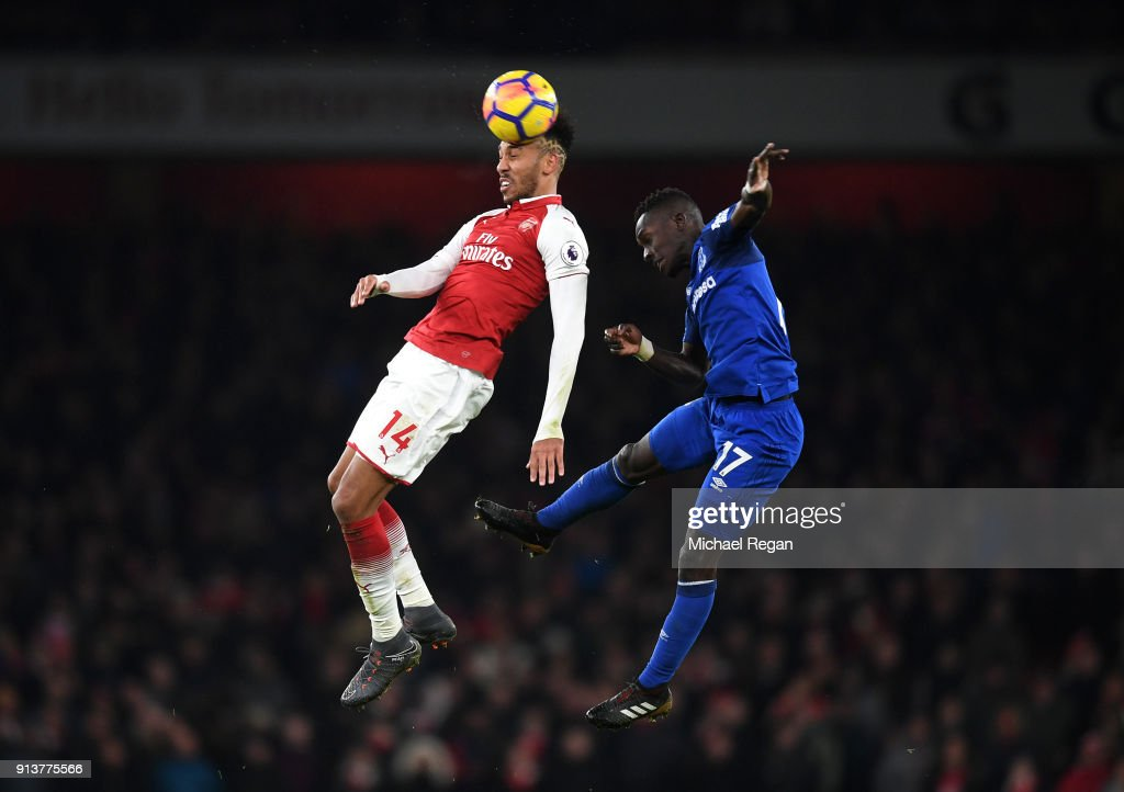 Pierre-Emerick Aubameyang of Arsenal wins a header over Idrissa Gueye of Everton during the Premier League match between Arsenal and Everton at Emirates Stadium on February 3, 2018 in London, England.