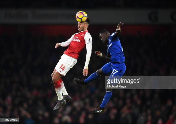 PierreEmerick Aubameyang of Arsenal wins a header over Idrissa Gueye of Everton during the Premier League match between Arsenal and Everton at...