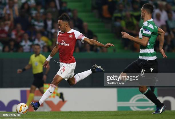 PierreEmerick Aubameyang of Arsenal with Andre Pinto of Sporting CP in action during the UEFA Europa League Group E match between Sporting CP and...