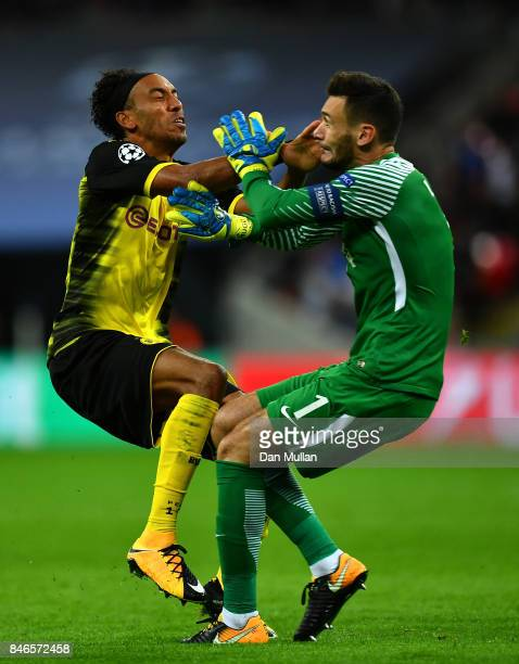 PierreEmerick Aubameyang of Borussia Dortmund and Hugo Lloris of Tottenham Hotspur colide during the UEFA Champions League group H match between...