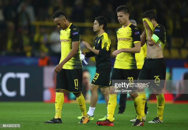 PierreEmerick Aubameyang of Borussia Dortmund and Julian Weigl of Borussia Dortmund are dejected after the UEFA Champions League group H match...