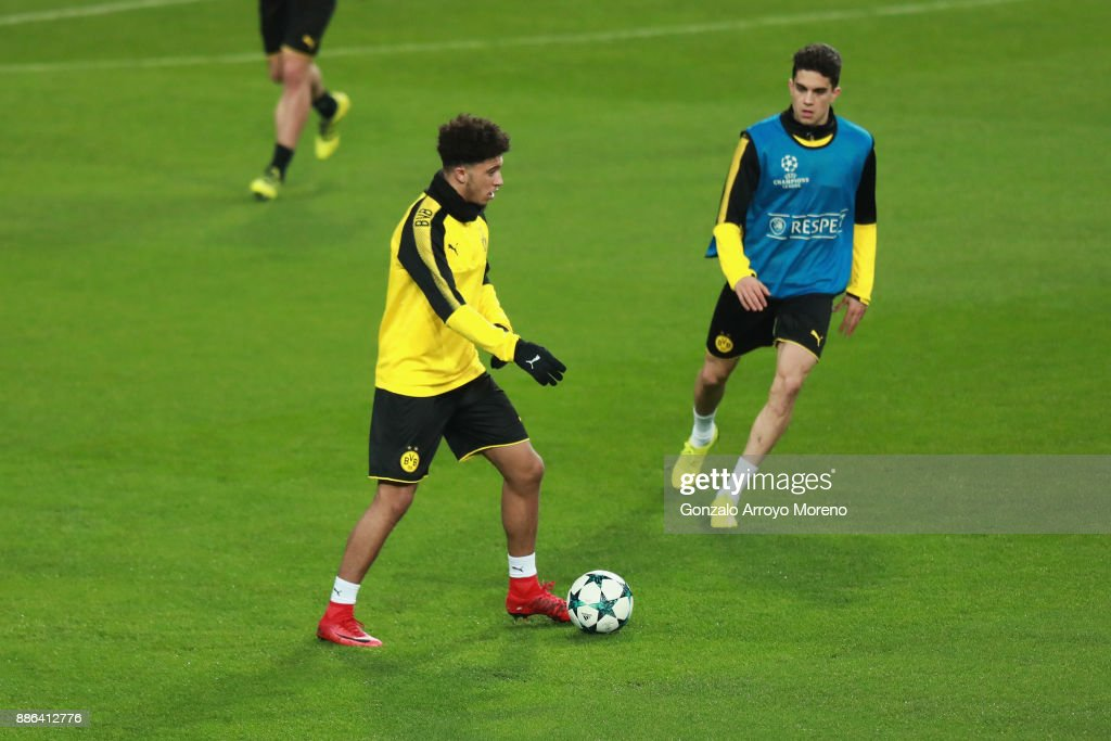 Pierre-Emerick Aubameyang of Borussia Dortmund (L) and Marc Bartra of Borussia Dortmund (R) in action during a training session at Estadio Santiago Bernabeu on December 5, 2017 in Madrid, Spain.