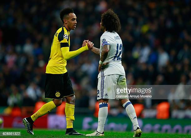 PierreEmerick Aubameyang of Borussia Dortmund and Marcelo of Real Madrid embrace after the final whistle during the UEFA Champions League Group F...