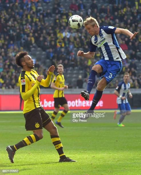 PierreEmerick Aubameyang of Borussia Dortmund and Per Skjelbred of Hertha BSC during the Bundesliga match between Hertha BSC and Borussia Dortmund at...