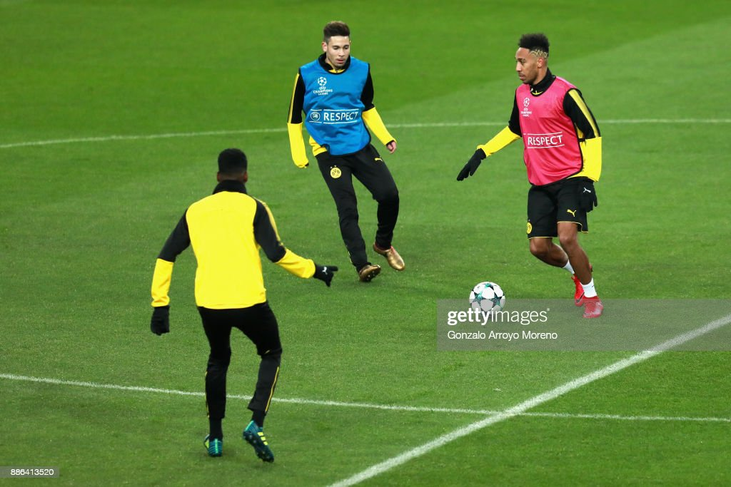Pierre-Emerick Aubameyang of Borussia Dortmund (R) and Raphael Guerreiro of Borussia Dortmund (middle) in action during a training session at Estadio Santiago Bernabeu on December 5, 2017 in Madrid, Spain.