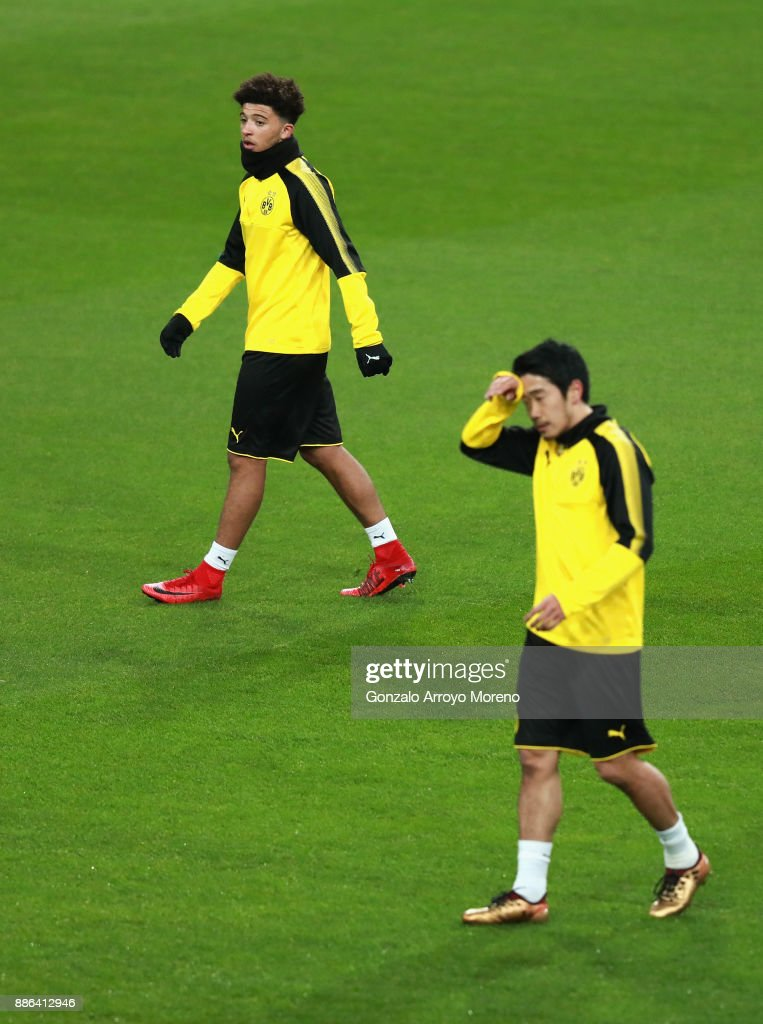 Pierre-Emerick Aubameyang of Borussia Dortmund (L) and Shinji Kagawa of Borussia Dortmund (R) looks on during a training session at Estadio Santiago Bernabeu on December 5, 2017 in Madrid, Spain.