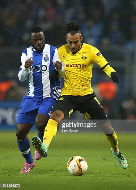 PierreEmerick Aubameyang of Borussia Dortmund and Silvestre Varela of FC Porto compete for the ball during the UEFA Europa League round of 32 first...