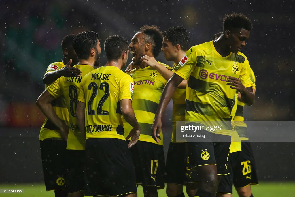 Pierre-Emerick Aubameyang of Borussia Dortmund celebrates a goal with Christian Pulisic and Nuri Sahin during the 2017 International Champions Cup football match between AC milan and Borussia Dortmund at University Town Sports Centre Stadium on July 18, 2017 in Guangzhou, China.