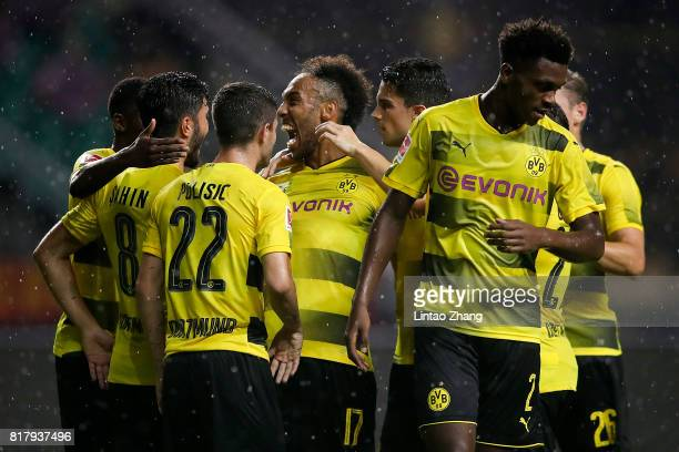 PierreEmerick Aubameyang of Borussia Dortmund celebrates a goal with Christian Pulisic and Nuri Sahin during the 2017 International Champions Cup...