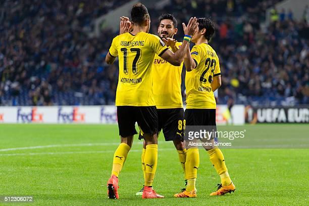 PierreEmerick Aubameyang of Borussia Dortmund celebrates after scoring the opening goal together with Shinji Kagawa and Ilkay Guendogan during the...