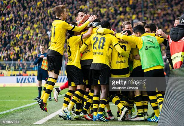 PierreEmerick Aubameyang of Borussia Dortmund celebrates after scoring the goal to the 50 together with his team mates during the Bundesliga match...