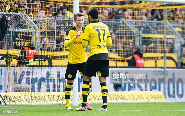 PierreEmerick Aubameyang of Borussia Dortmund celebrates after scoring the goal to the 40 together with Marco Reus during the Bundesliga match...