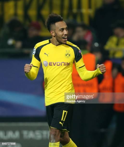 PierreEmerick Aubameyang of Borussia Dortmund celebrates after winning the UEFA Champions League round of 16 soccer match between Borussia Dortmund...