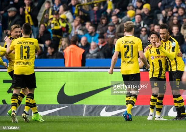 PierreEmerick Aubameyang of Borussia Dortmund celebrates after scoring the goal to the 11 together with Shinji Kagawa during the Bundesliga match...