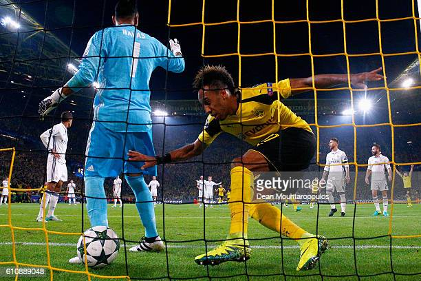 PierreEmerick Aubameyang of Borussia Dortmund celebrates and goes to collect the ball after he scores their first goal past goalkepper Keylor Navas...